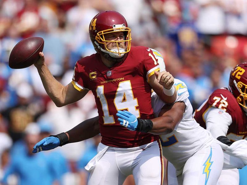 LANDOVER, MARYLAND - SEPTEMBER 12: Ryan Fitzpatrick #14 of the Washington Football Team takes a hit against the Los Angeles Chargers during the second quarter at FedExField on September 12, 2021 in Landover, Maryland. (Photo by Patrick Smith/Getty Images)
