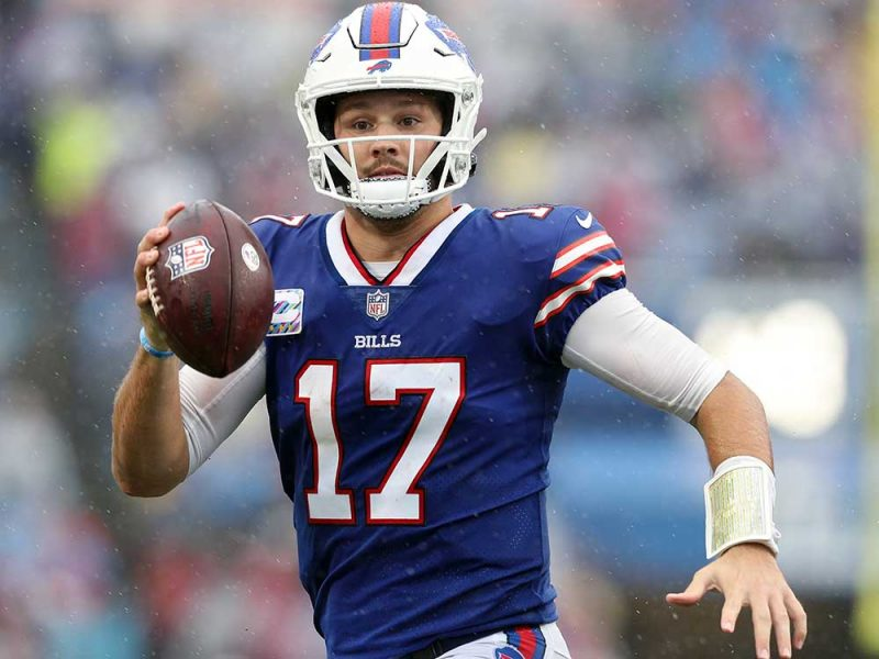 ORCHARD PARK, NEW YORK - OCTOBER 03: Quarterback Josh Allen #17 of the Buffalo Bills looks to pass against the Houston Texans in the fourth quarter at Highmark Stadium on October 03, 2021 in Orchard Park, New York. (Photo by Bryan M. Bennett/Getty Images)